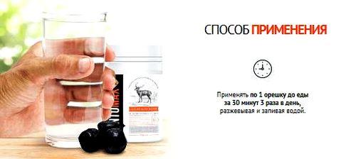 стакан воды в руке и упаковка препарата